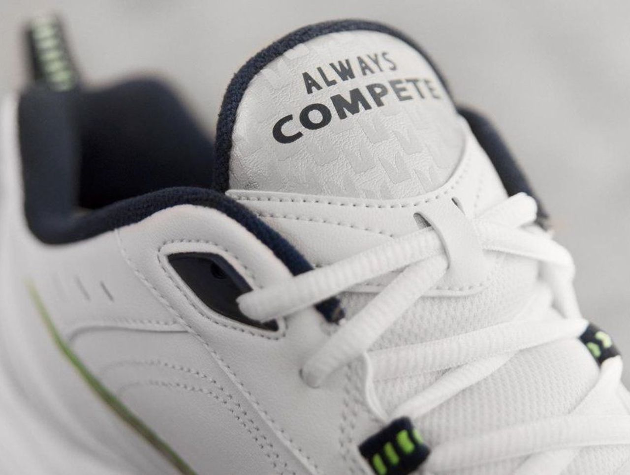0e50bd0287f6 Pete Carroll s new Nike Air Monarchs feature his  Always Compete  mantra