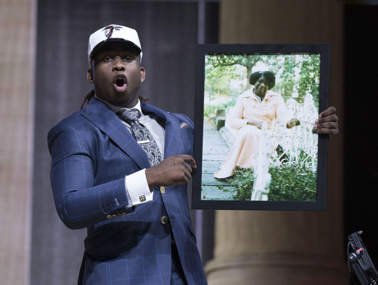 Falcons' McKinley blasts Clay Travis for mocking photo of grandmother