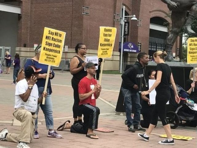 Small crowd protests outside stadium for Ravens to sign Kaepernick
