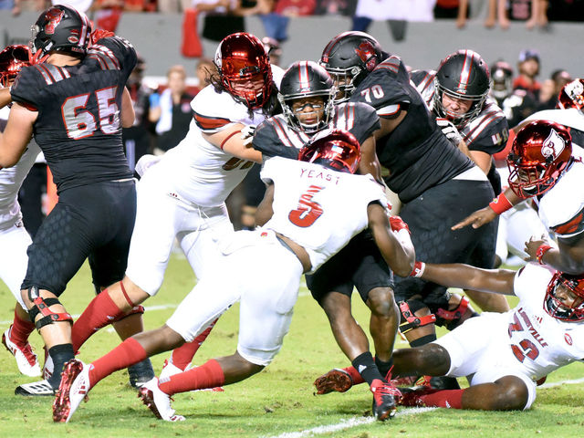 Hines carries NC State past Louisville