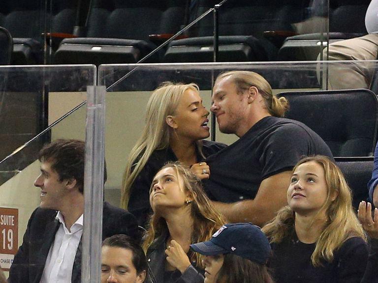 Watch: Thor savors hockey, girlfriend's fingers during Rangers game