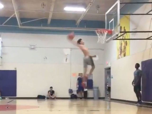Watch: LaMelo Ball soars for smooth windmill dunk