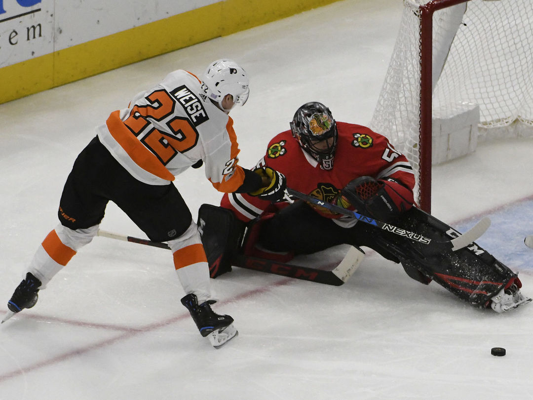 Crawford shines as Blackhawks blank Flyers to snap 3-game losing skid