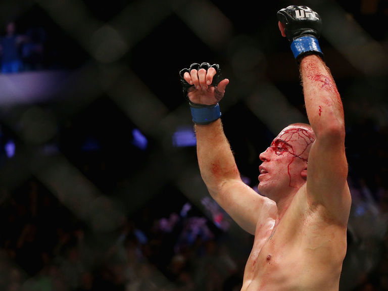 GSP chokes Bisping out, wins UFC middleweight title in return