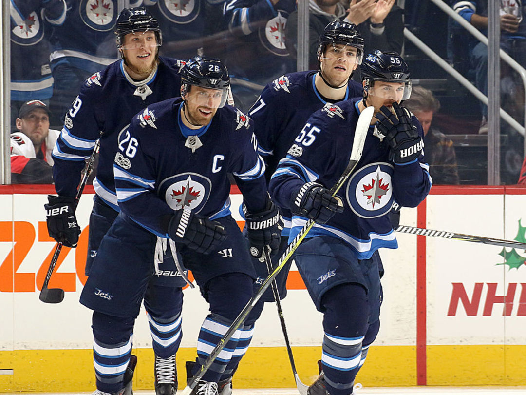 Wheeler takes over NHL assist lead with 4-point night
