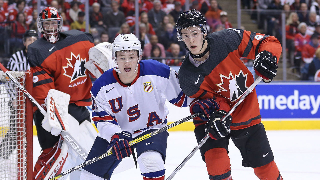 TORONTO,ON - DECEMBER 31: Joey Anderson #13 of Team USA skates against Philippe Myers #6 of Team Canada during a preliminary round game in the 2017 IIHF World Junior Hockey Championship at the Air Canada Centre on December 31, 2016 in Toronto, Ontario, Canada. The USA defeated Canada 3-1. (Photo by Claus Andersen/Getty Images)