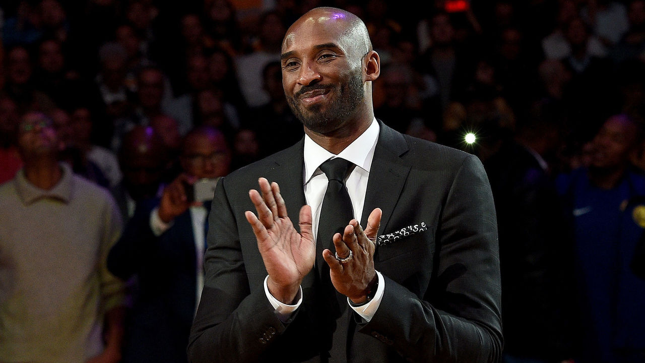 LOS ANGELES, CA - DECEMBER 18: Kobe Bryant smiles at halftime as both his #8 and #24 Los Angeles Lakers jerseys are retired at Staples Center on December 18, 2017 in Los Angeles, California. (Photo by Kevork Djansezian/Getty Images)