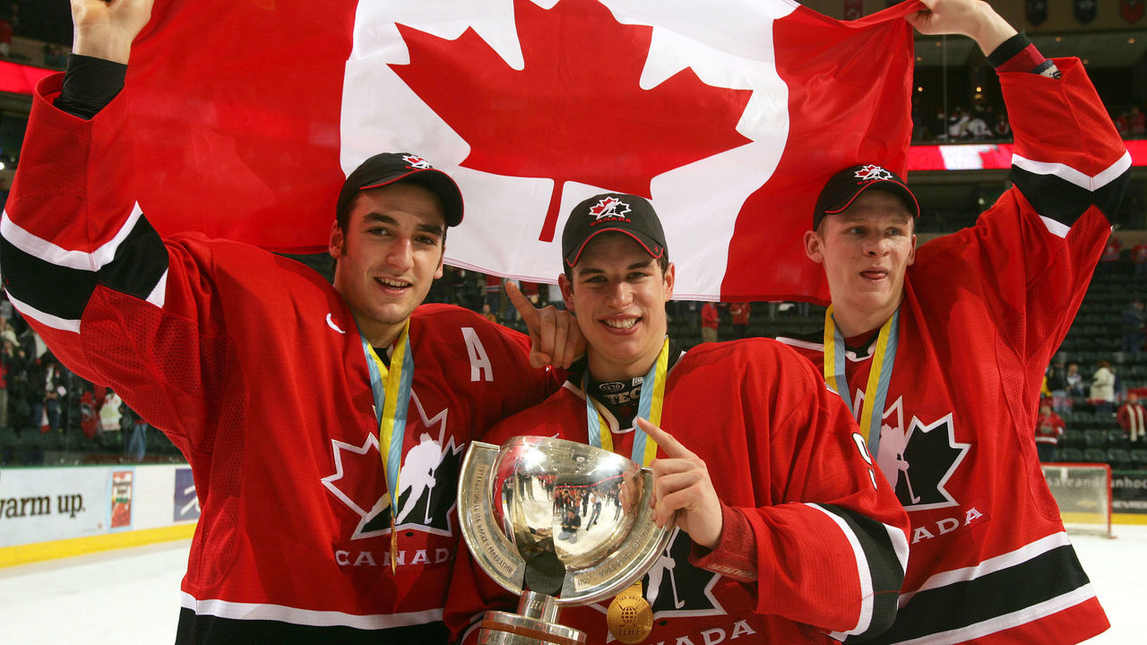 GRAND FORKS, ND - JANUARY 4: Corey Perry #24, Sidney Crosby #9 and Patrice Begeron #37 hold the World Junior Championship trophy after Canada won the gold medal game 6-1 over Russia at the World Junior Hockey Championships on January 4, 2005 at the Ralph Englestad Arena in Grand Forks, North Dakota.