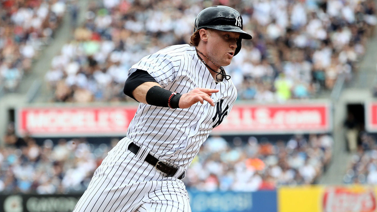 NEW YORK, NY - JULY 26: Clint Frazier #77 of the New York Yankees rounds third and heads for home in the seventh inning against the Cincinnati Reds on July 26, 2017 at Yankee Stadium in the Bronx borough of New York City.