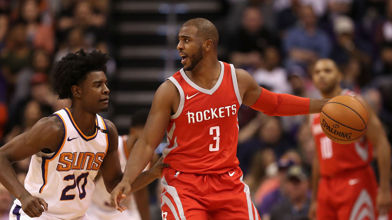 PHOENIX, AZ - NOVEMBER 16: Chris Paul #3 of the Houston Rockets handles the ball under pressure from Josh Jackson #20 of the Phoenix Suns during the second half of the NBA game at Talking Stick Resort Arena on November 16, 2017 in Phoenix, Arizona.