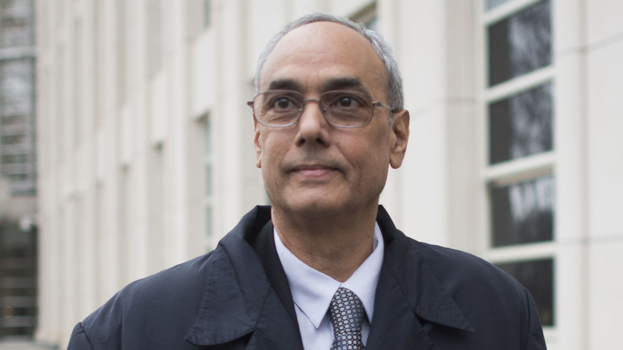 Former president of the Peruvian Football Association Manuel Burga, one of three defendants in the FIFA scandal departs the Federal Courthouse in Brooklyn on December 22, 2017 in New York. A US jury convicted two South American ex-soccer bosses of corruption but will return after Christmas to deliberate on the fate of a third defendant in the FIFA trial in New York. But the jury said they had not yet reached consensus on former Peru boss Manuel Burga, who faces one count of racketeering conspiracy. They will return to resume deliberations on Tuesday, after the Christmas holiday. / AFP PHOTO / DON EMMERT