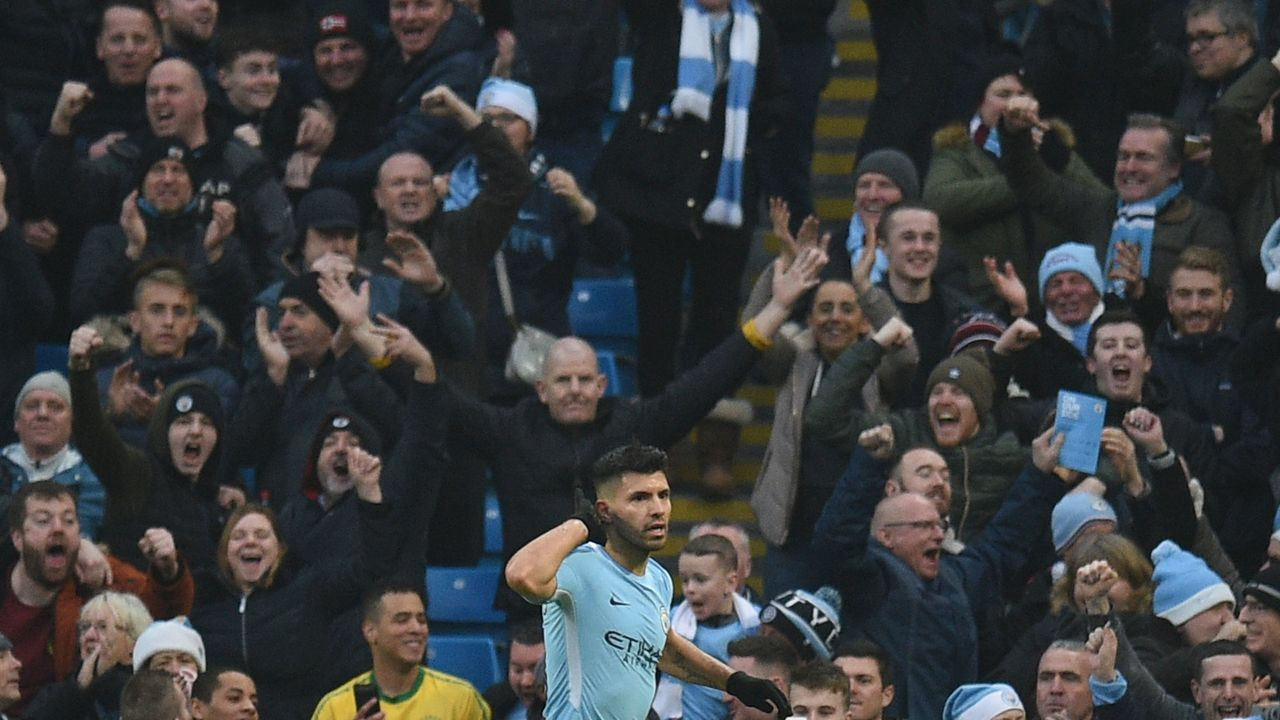 Manchester City's Argentinian striker Sergio Aguero celebrates scoring the opening goal during the English Premier League football match between Manchester City and Bournemouth at the Etihad Stadium in Manchester, north west England, on December 23, 2017. / AFP PHOTO / Oli SCARFF /