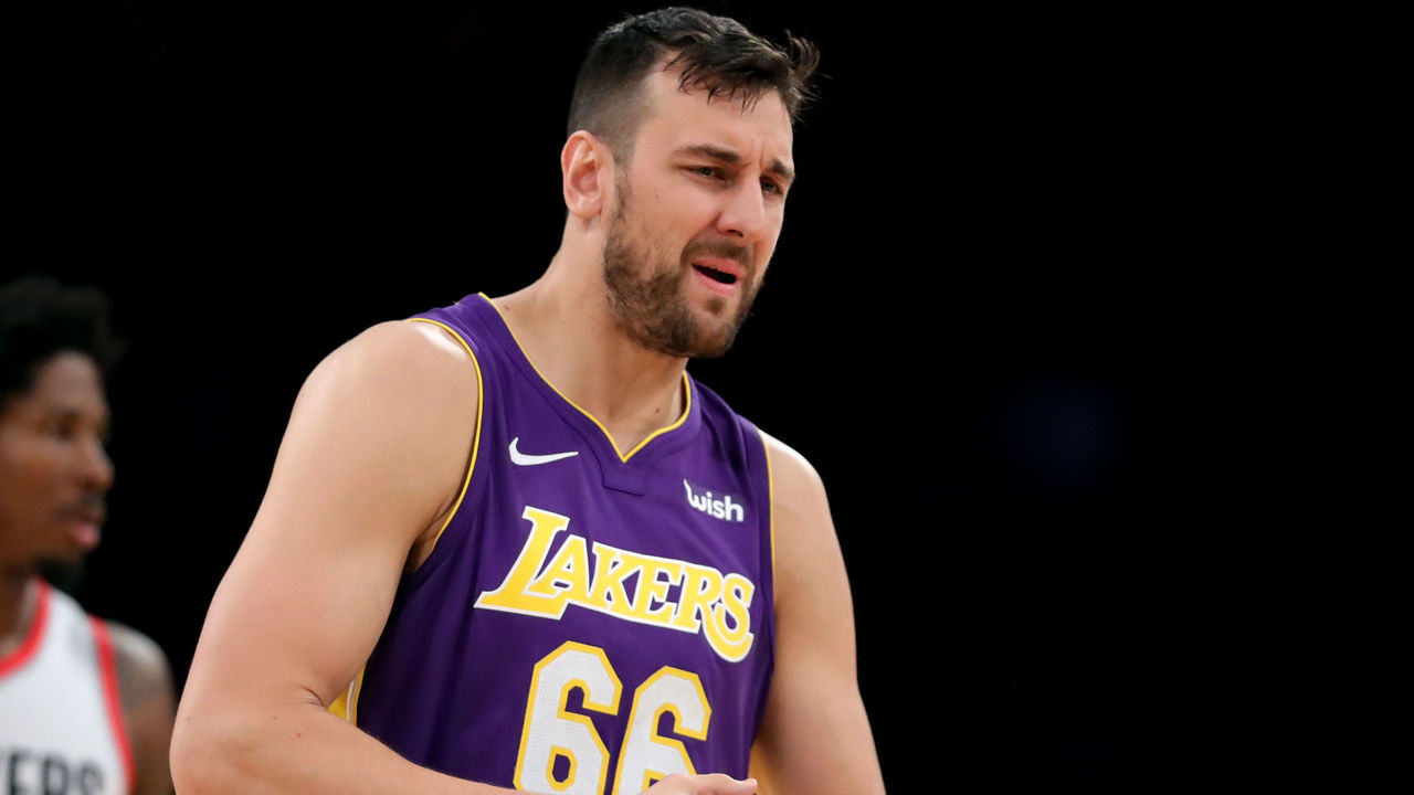 LOS ANGELES, CA - DECEMBER 23: Andrew Bogut #66 of the Los Angeles Lakers reacts to fouling out as Ed Davis #17 of the Portland Trail Blazers looks on during the second half of a game at Staples Center on December 23, 2017 in Los Angeles, California.