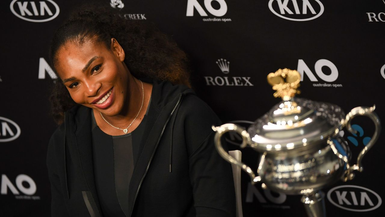 Serena Williams of the US speaks next to her championship trophy during a press conference after her victory against Venus Williams of the US in the women's singles final on day 13 of the Australian Open tennis tournament in Melbourne on January 28, 2017. / AFP / WILLIAM WEST / IMAGE RESTRICTED TO EDITORIAL USE - STRICTLY NO COMMERCIAL USE