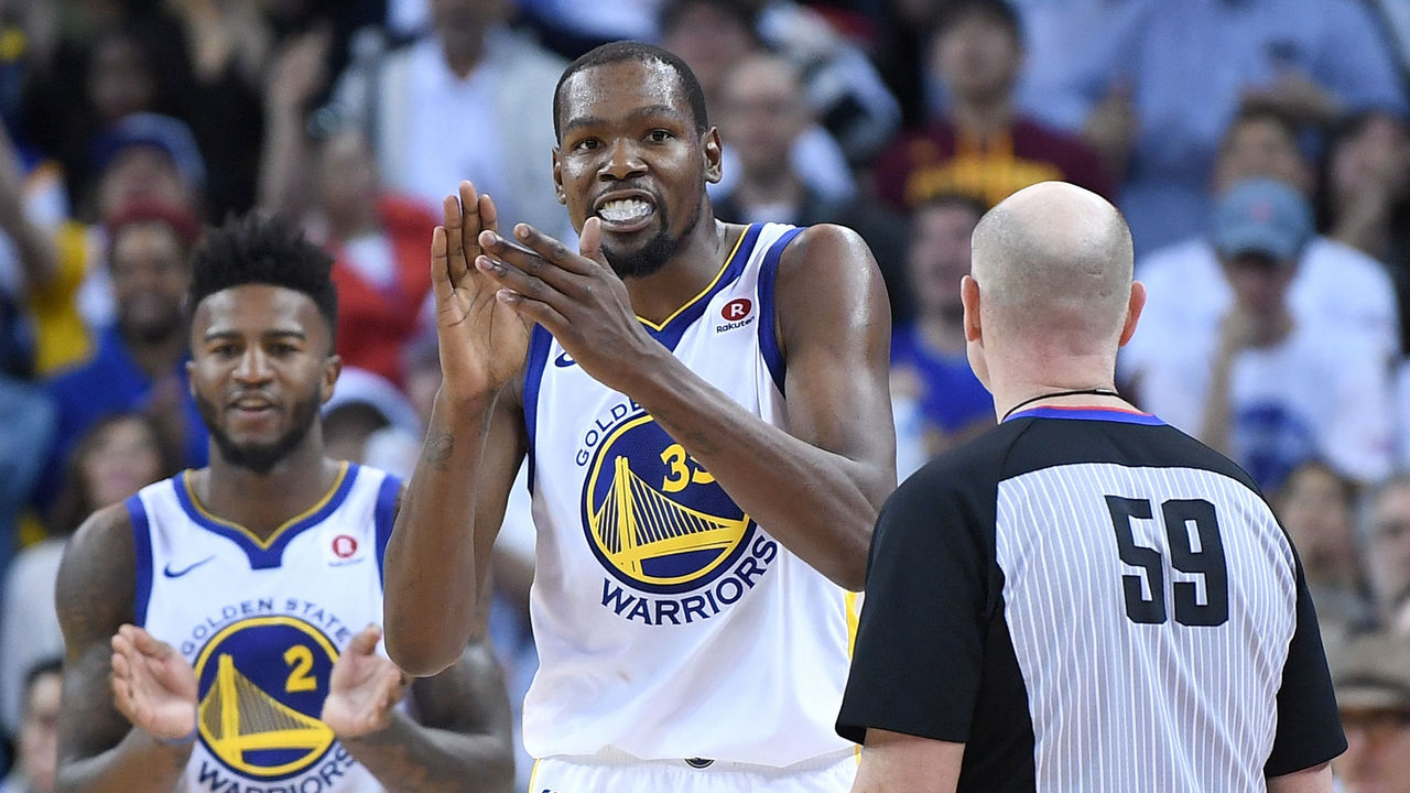 OAKLAND, CA - DECEMBER 25: Kevin Durant #35 of the Golden State Warriors reacts after blocking the shot of LeBron James #23 of the Cleveland Cavaliers late in the fouth quarter of an NBA basketball game at ORACLE Arena on December 25, 2017 in Oakland, California.