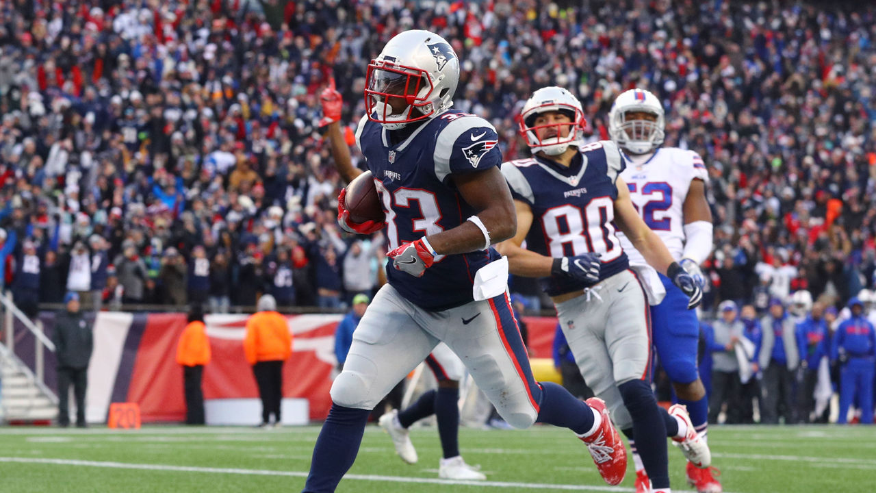 FOXBORO, MA - DECEMBER 24: Dion Lewis #33 of the New England Patriots scores a touchdown against the Buffalo Bills during the first half at Gillette Stadium on December 24, 2017 in Foxboro, Massachusetts.