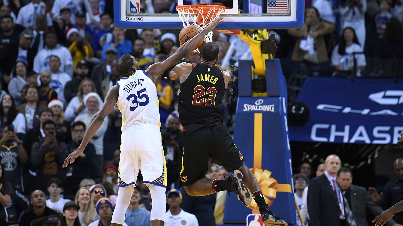 OAKLAND, CA - DECEMBER 25: Kevin Durant #35 of the Golden State Warriors blocks the shot of LeBron James #23 of the Cleveland Cavaliers late in the fouth quarter of an NBA basketball game at ORACLE Arena on December 25, 2017 in Oakland, California.