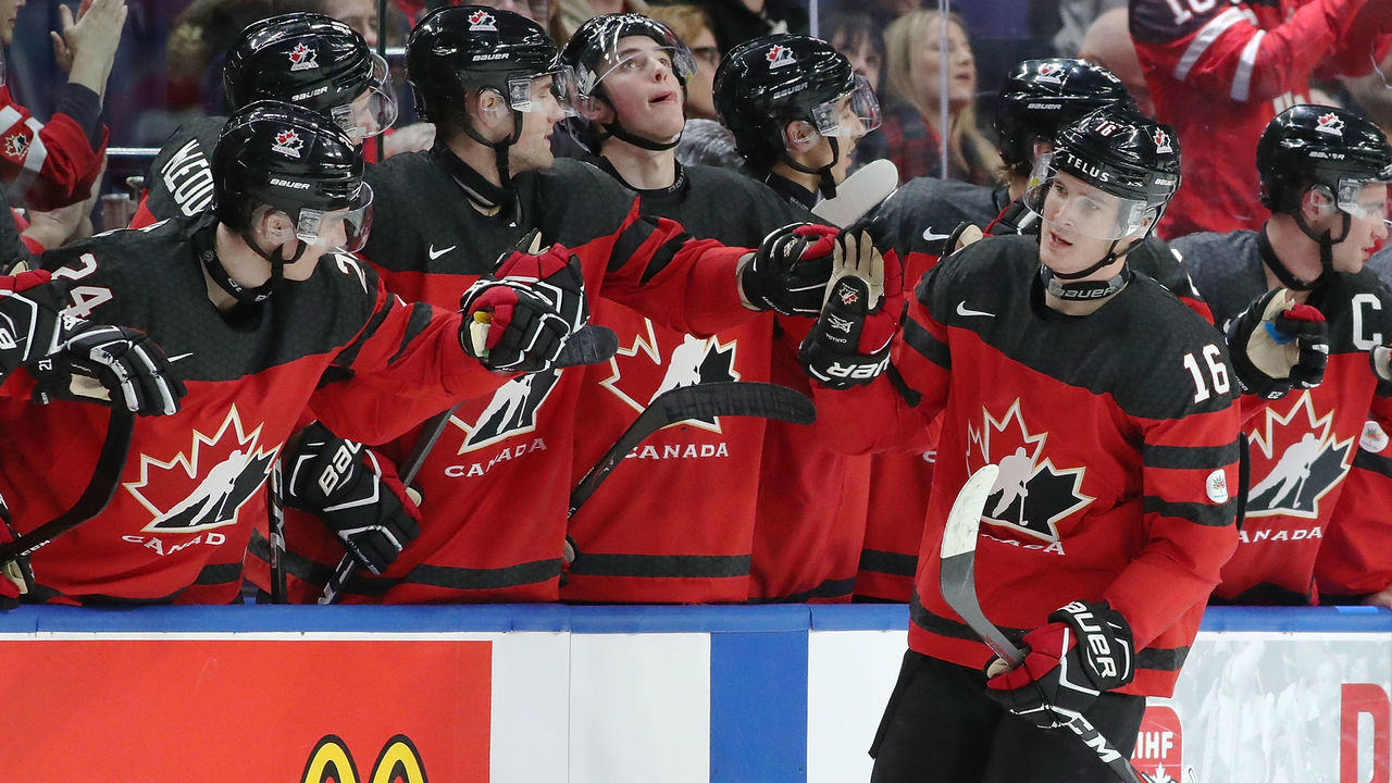 BUFFALO, NY - DECEMBER 26: Taylor Raddysh #16 of Canada celebrates with the bench after he scored on Finland during the second period at KeyBank Center on December 26, 2017 in Buffalo, New York.