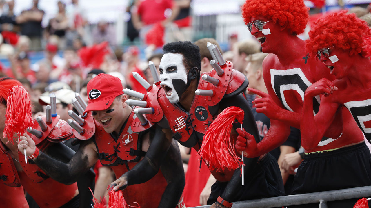 JACKSONVILLE, FL - OCTOBER 28: Georgia Bulldogs fans celebrate in the first quarter of a game against the Florida Gators at EverBank Field on October 28, 2017 in Jacksonville, Florida.