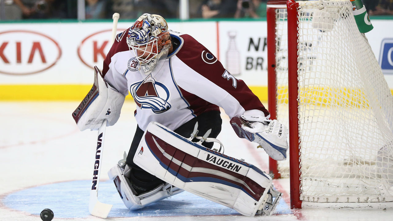 DALLAS, TEXAS - APRIL 07: Calvin Pickard #31 of the Colorado Avalanche makes a save against the Dallas Stars in the first period at American Airlines Center on April 7, 2016 in Dallas, Texas.