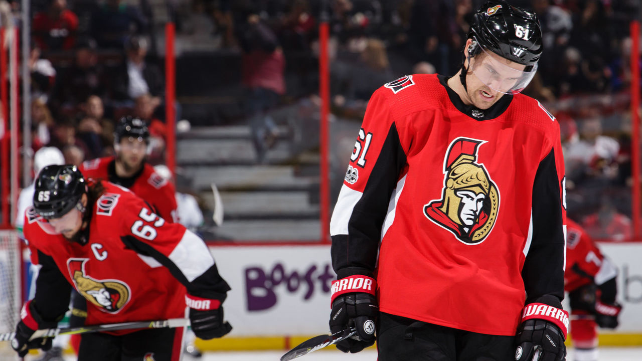 OTTAWA, ON - OCTOBER 17: Mark Stone #61 and Erik Karlsson #65 of the Ottawa Senators react after losing to the Vancouver Canucks at Canadian Tire Centre on October 17, 2017 in Ottawa, Ontario, Canada. *** Local Caption ***