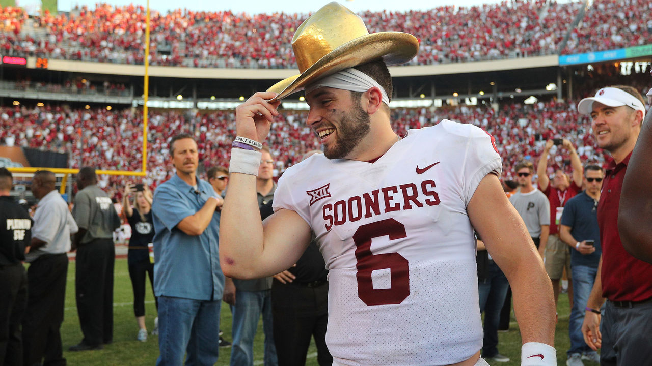 DALLAS, TX - OCTOBER 14: Baker Mayfield #6 of the Oklahoma Sooners wears the Golden Hat Trophy after the 29-24 win over the Texas Longhorns at Cotton Bowl on October 14, 2017 in Dallas, Texas.
