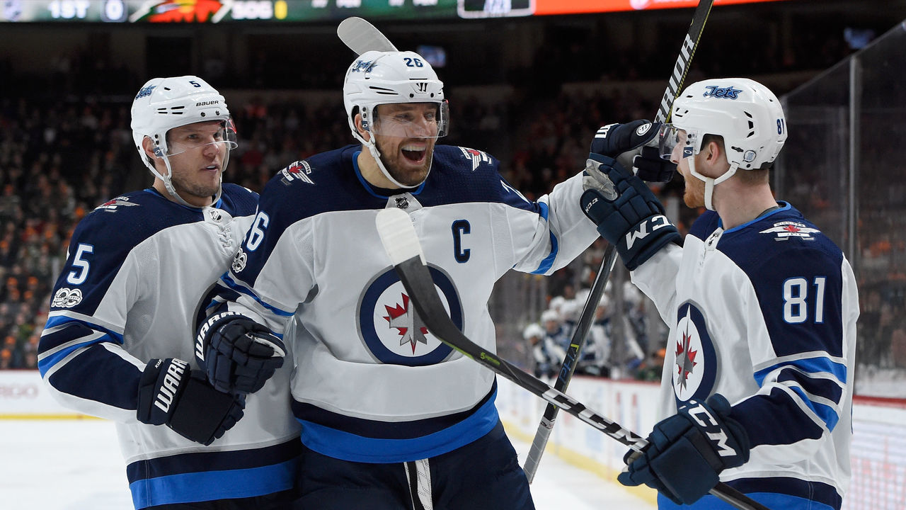ST PAUL, MN - OCTOBER 31: Dmitry Kulikov #5 and Blake Wheeler #26 of the Winnipeg Jets congratulate teammate Kyle Connor #81 on scoring a goal against the Minnesota Wild during the first period of the game on October 31, 2017 at Xcel Energy Center in St Paul, Minnesota.
