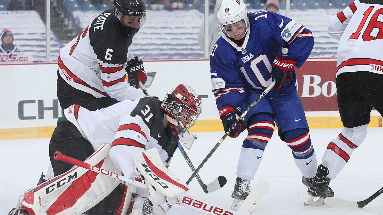 BUFFALO, NY - DECEMBER 29: Will Lockwood #10 of United States is stopped by Carter Hart #31 of Canada in the first period during the IIHF World Junior Championship at New Era Field on December 29, 2017 in Buffalo, New York.