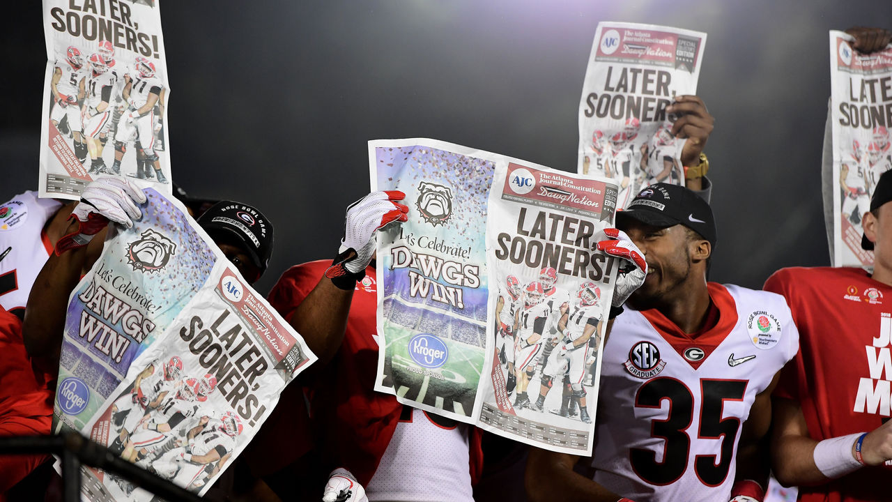 PASADENA, CA - JANUARY 01: The Georgia Bulldogs celebrate with newspapers after the Bulldogs beat the Oklahoma Sooners 54-48 in double overtime in the 2018 College Football Playoff Semifinal Game at the Rose Bowl Game presented by Northwestern Mutual at the Rose Bowl on January 1, 2018 in Pasadena, California.