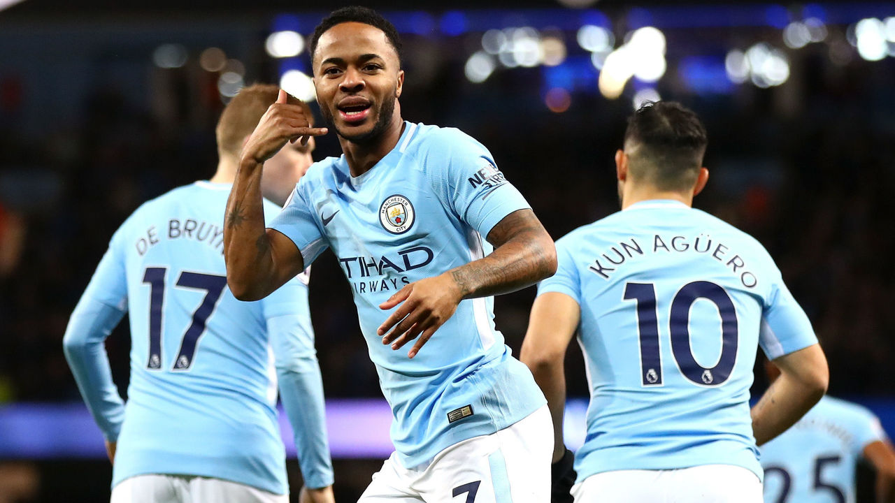 MANCHESTER, ENGLAND - JANUARY 02: Raheem Sterling of Manchester City celebrates after scoring his sides first goal during the Premier League match between Manchester City and Watford at Etihad Stadium on January 2, 2018 in Manchester, England.