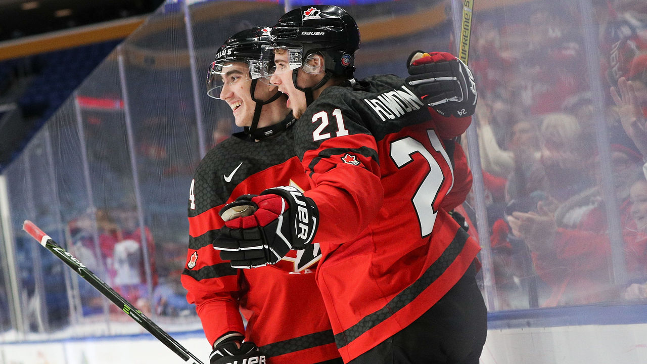 BUFFALO, NY - JANUARY 02: Brett Howden #21 of Canada celebrates his goal with Alex Formenton #24 of Canada during the first period of play in the Quarterfinal IIHF World Junior Championship game at the KeyBank Center on January 2, 2018 in Buffalo, New York.