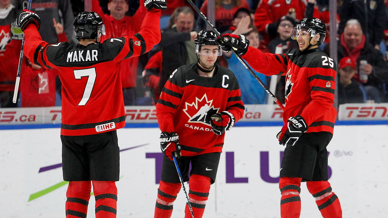 BUFFALO, NY - JANUARY 02: Cale Makar #7, Dillon Dubé #9 and Jordan Kyrou #25 of Canada celebrate Canada's 5th goal of the game during the second period of play in the Quarterfinal IIHF World Junior Championship game at the KeyBank Center on January 2, 2018 in Buffalo, New York.