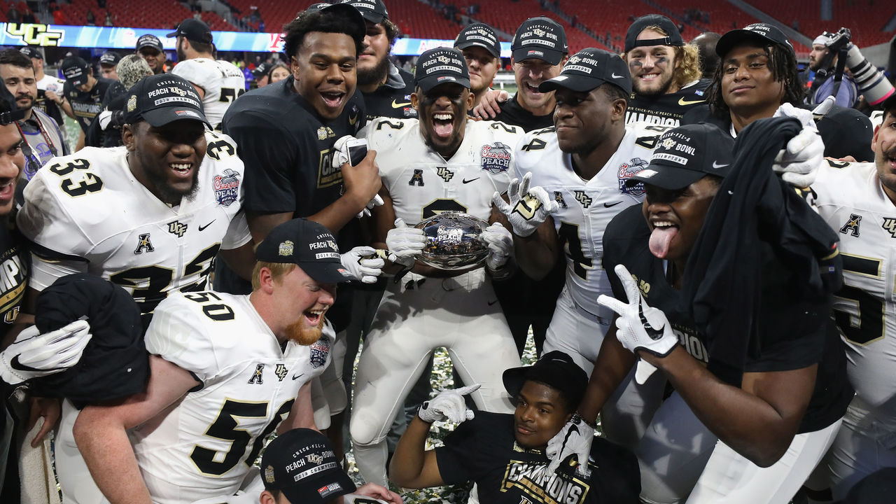 ATLANTA, GA - JANUARY 01: The UCF Knights celebrate defeating the Auburn Tigers 34-27 to win the Chick-fil-A Peach Bowl at Mercedes-Benz Stadium on January 1, 2018 in Atlanta, Georgia.