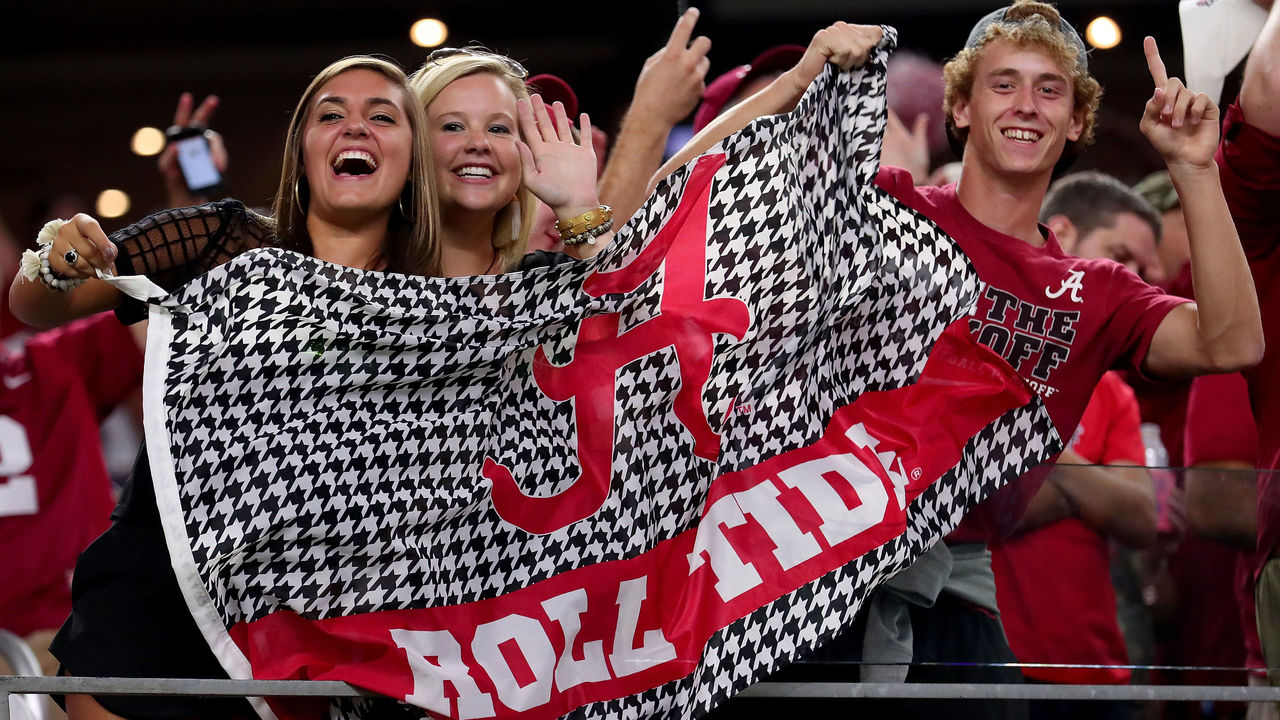 ARLINGTON, TX - SEPTEMBER 03: Alabama Crimson Tide fans celebrate after Alabama scores a touchdown against the USC Trojans in the third quarter during the AdvoCare Classic at AT&T Stadium on September 3, 2016 in Arlington, Texas.