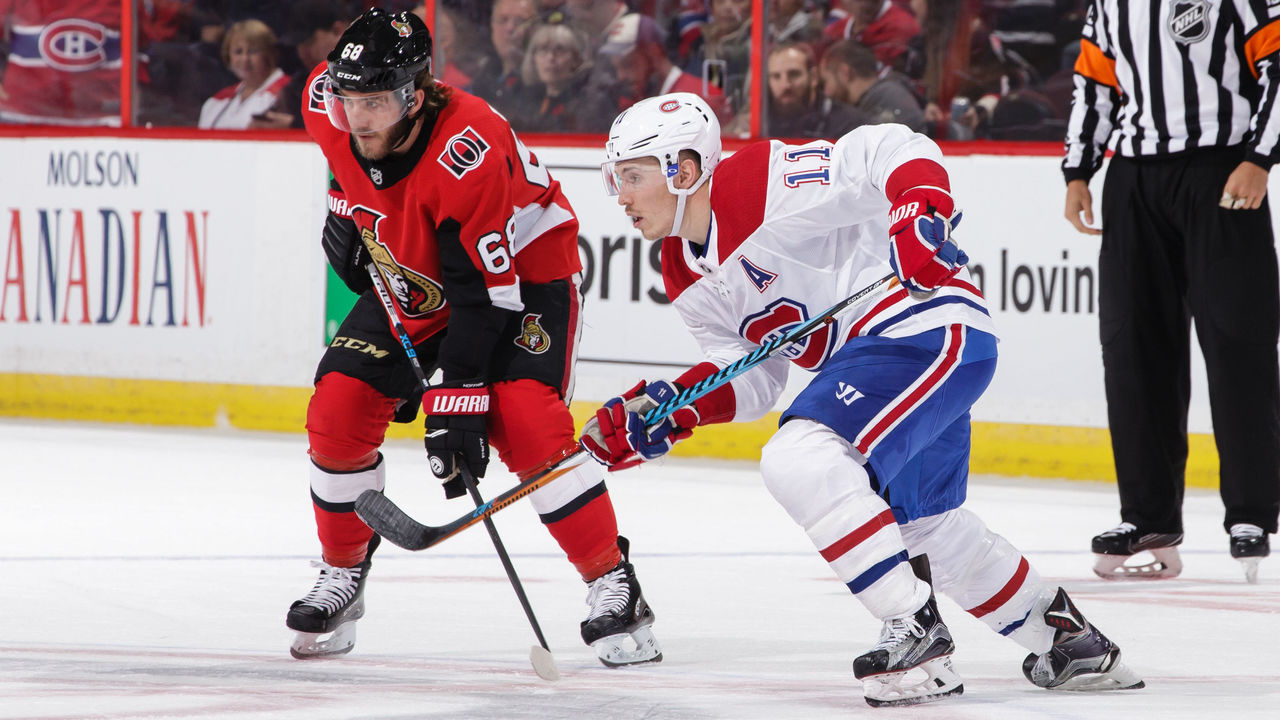 OTTAWA, ON - OCTOBER 30: Mike Hoffman #68 of the Ottawa Senators takes a face-off against Brendan Gallagher #11 of the Montreal Canadiens at Canadian Tire Centre on October 30, 2017 in Ottawa, Ontario, Canada.