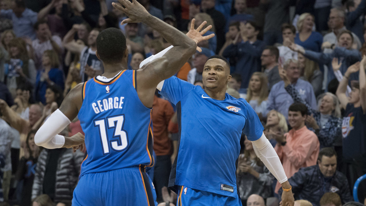 OKLAHOMA CITY, OK - NOVEMBER 22: Paul George #13 of the Oklahoma City Thunder and Russell Westbrook #0 of the Oklahoma City Thunder celebrate during the second half of a NBA game against the Golden State Warriors at the Chesapeake Energy Arena on November 22, 2017 in Oklahoma City, Oklahoma.