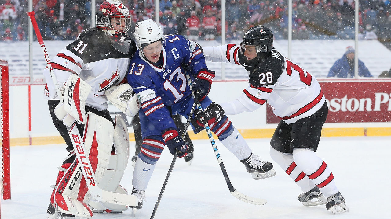 BUFFALO, NY - DECEMBER 29: Victor Mete #28 of Canada pushes Joey Anderson #13 of United States into Carter Hart #31 in the first period during the IIHF World Junior Championship at New Era Field on December 29, 2017 in Buffalo, New York.