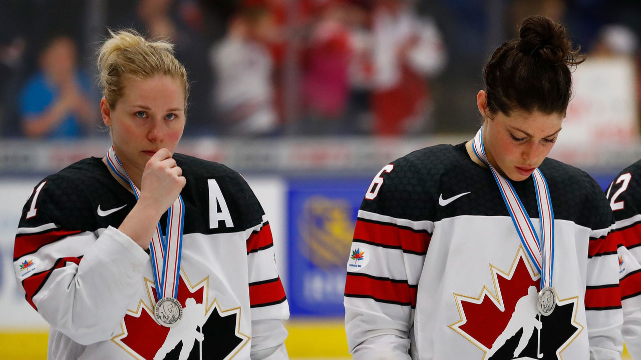 PLYMOUTH, MI - APRIL 07: Haley Irwin #21, Rebecca Johnston #6 and Meaghan Mikkelson #12 of Canada react after losing 3-2 in overtime to the the United States in the gold medal game at the 2017 IIHF Woman's World Championships at USA Hockey Arena on April 7, 2017 in Plymouth, Michigan.