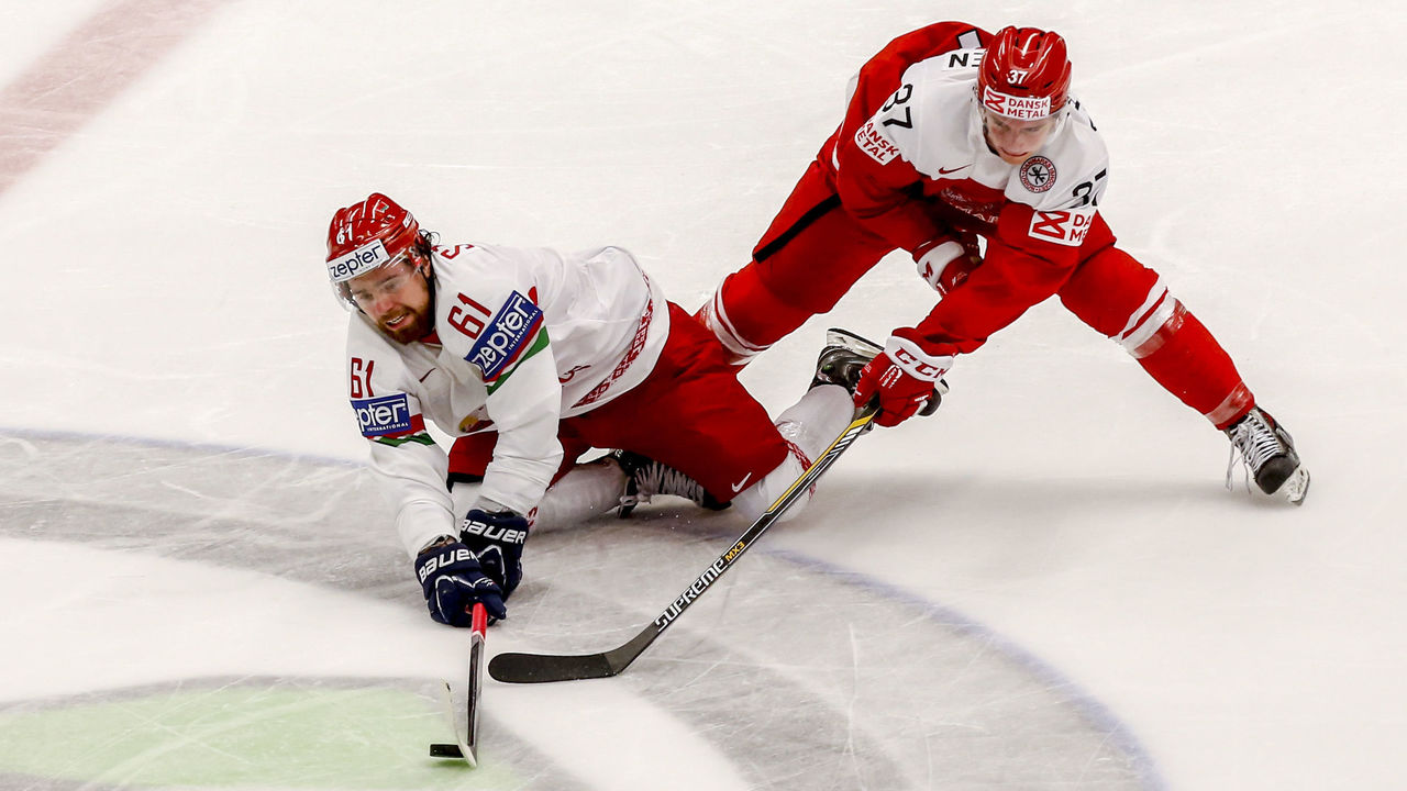 OSTRAVA, CZECH REPUBLIC - MAY 05: Anders Poulsen (R) of Denmark and Andrei Stepanov (L) of Belarus battle for the puck during the IIHF World Championship group B match between Denmark and Belarus at CEZ Arena on May 5, 2015 in Ostrava, Czech Republic.