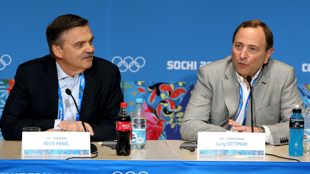 SOCHI, RUSSIA - FEBRUARY 18: (L-R) International Ice Hockey Federation President Rene Fasel and National Hockey League Commissioner Gary Bettman speak during a press conference on day eleven of the Sochi 2014 Winter Olympics on February 18, 2014 in Sochi, Russia.