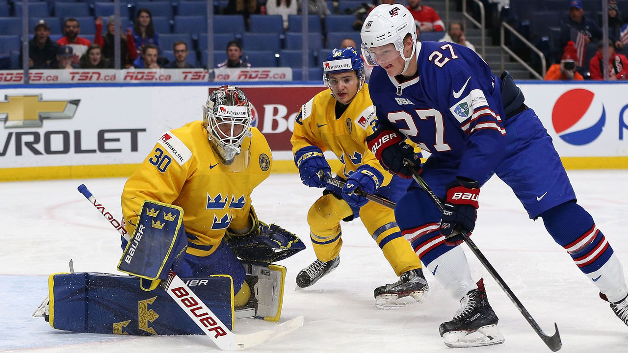 BUFFALO, NY - JANUARY 4: Filip Gustavsson #30 of Sweden makes the save against Riley Tufte #27 of United States in the second period during the IIHF World Junior Championship at KeyBank Center on January 4, 2018 in Buffalo, New York.