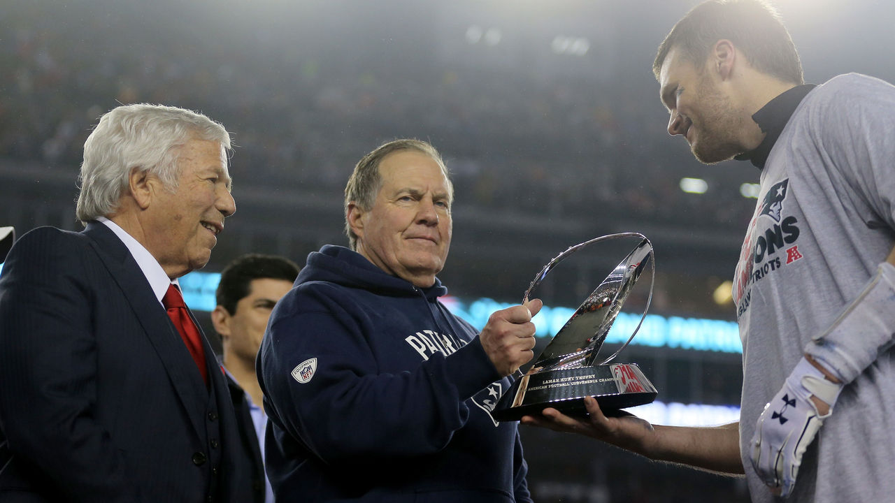 FOXBORO, MA - JANUARY 22: (L-R) Robert Kraft, owner and CEO of the New England Patriots, head coach Bill Belichick of the New England Patriots and Tom Brady #12 celebrate with the Lamar Hunt Trophy after defeating the Pittsburgh Steelers 36-17 to win the AFC Championship Game at Gillette Stadium on January 22, 2017 in Foxboro, Massachusetts.