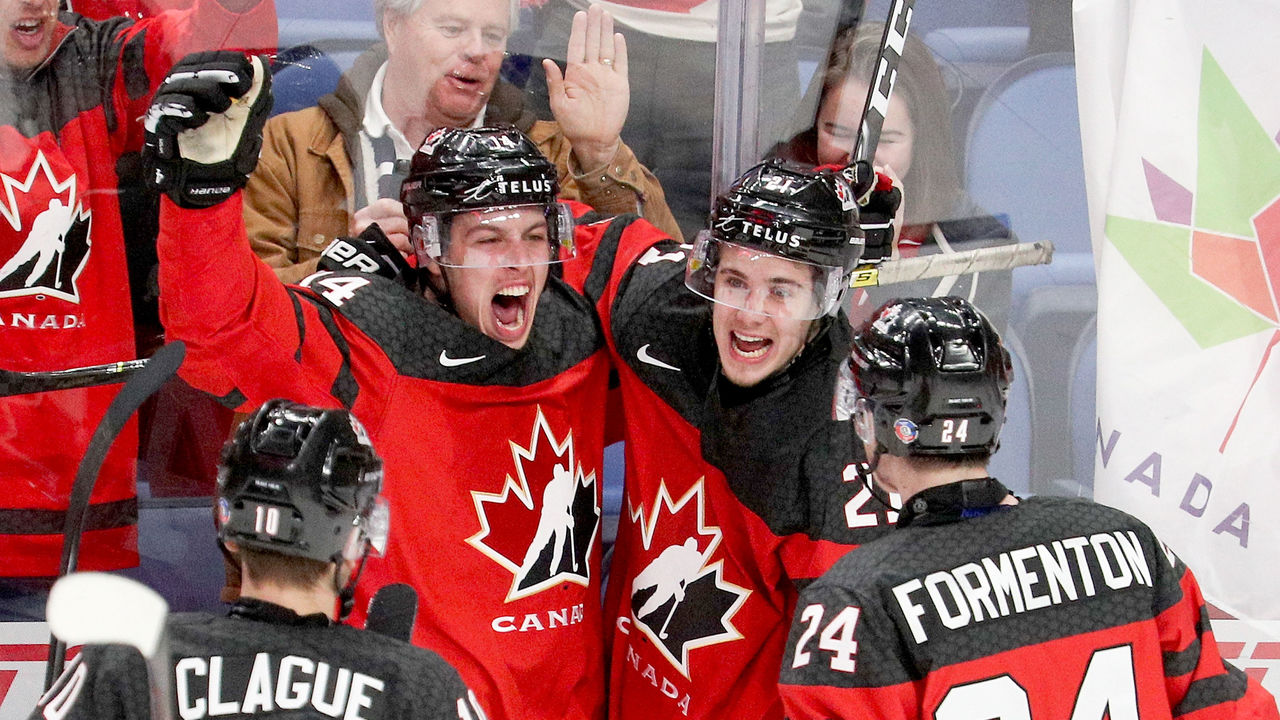 BUFFALO, NY - JANUARY 04: Maxime Comtois #14 of Canada celebrates with Kale Clague #10, Alex Formenton #24, and Brett Howden #21 after Comtois' goal gave team Cananda a 4-1 lead during the second period of play in the IIHF World Junior Championships Semifinal game at KeyBank Center on January 4, 2018 in Buffalo, New York.