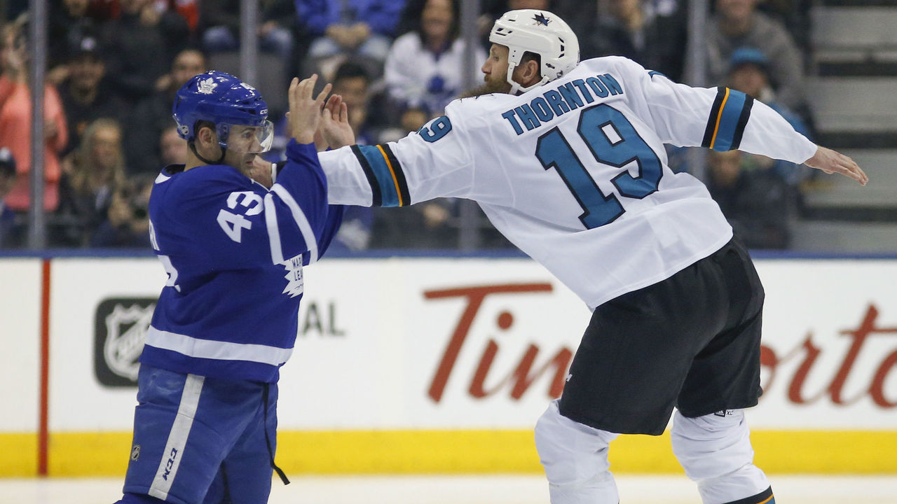 TORONTO, ON - JANUARY 4: The talk began before the puck drop, and the gloves dropped as did the puck. Toronto Maple Leafs center Nazem Kadri (43) and San Jose Sharks center Joe Thornton (19) do a little dance. Toronto Maple Leafs VS San Jose Sharks during 1st period action in NHL regular season play at the Air Canada Centre. Toronto Star/Rick Madonik (Rick Madonik/Toronto Star via Getty Images)