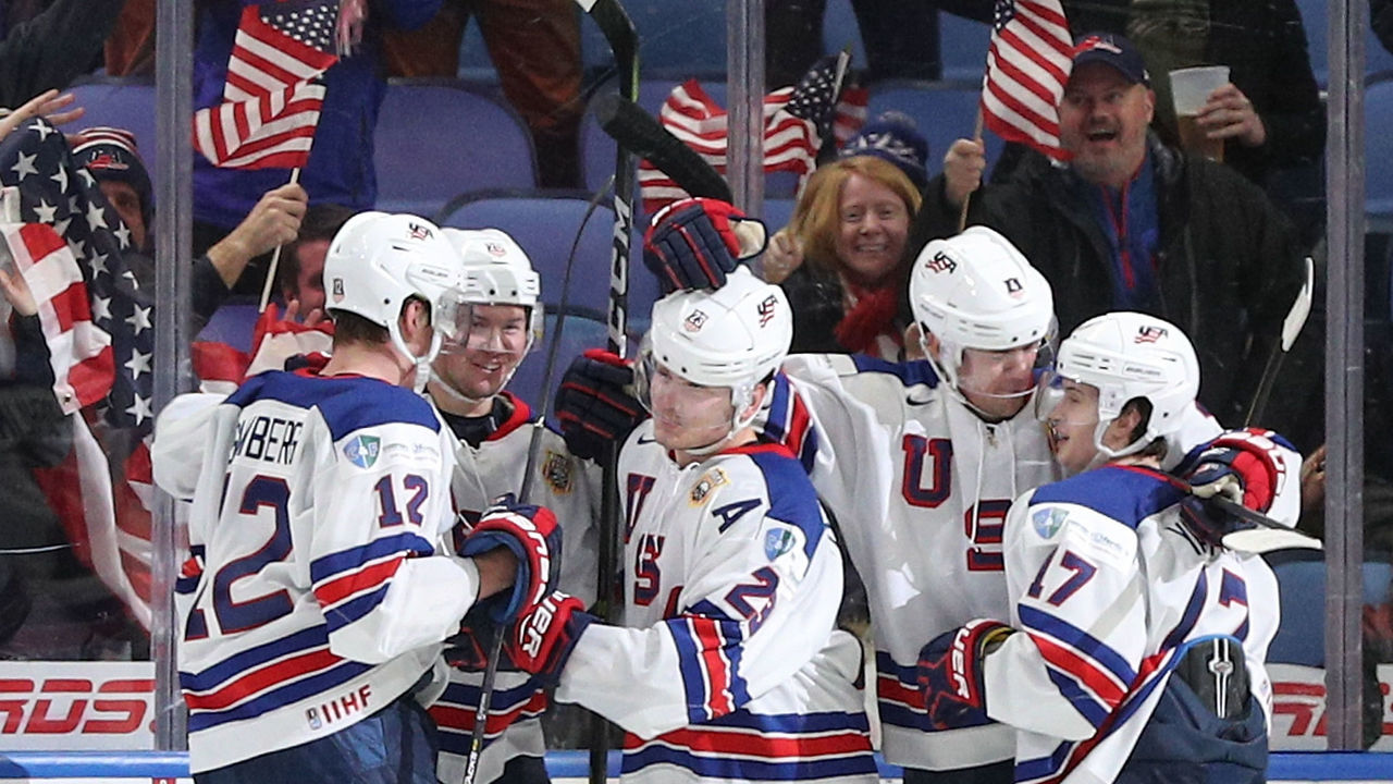 BUFFALO, NY - JANUARY 02: Kieffer Bellows #23 of United States celebrates his second goal of the game against team Russia with his teammates Dylan Samberg #12, Phil Kemp #25, Ryan Poehling #4 and Kailer Yamamoto #17 during the third period of play in the Quarterfinal IIHF World Junior Championship game at the KeyBank Center on January 2, 2018 in Buffalo, New York.