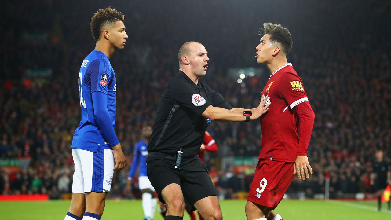 LIVERPOOL, ENGLAND - JANUARY 05: Referee Robert Madley intervenes as Mason Holgate of Everton and Roberto Firmino of Liverpool clash during the Emirates FA Cup Third Round match between Liverpool and Everton at Anfield on January 5, 2018 in Liverpool, England.