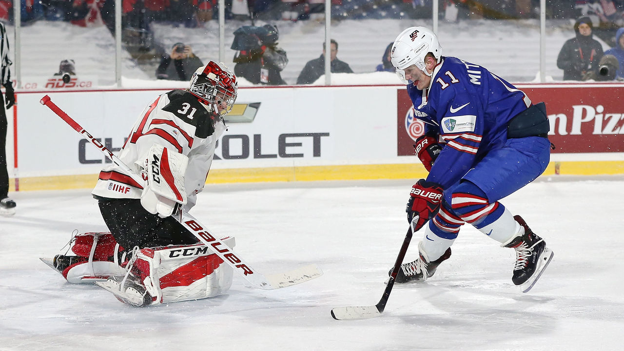 BUFFALO, NY - DECEMBER 29: Carter Hart #31 of Canada makes the save against Casey Mittelstadt #11 of United States during the IIHF World Junior Championship at New Era Field on December 29, 2017 in Buffalo, New York. The United States beat Canada 4-3.