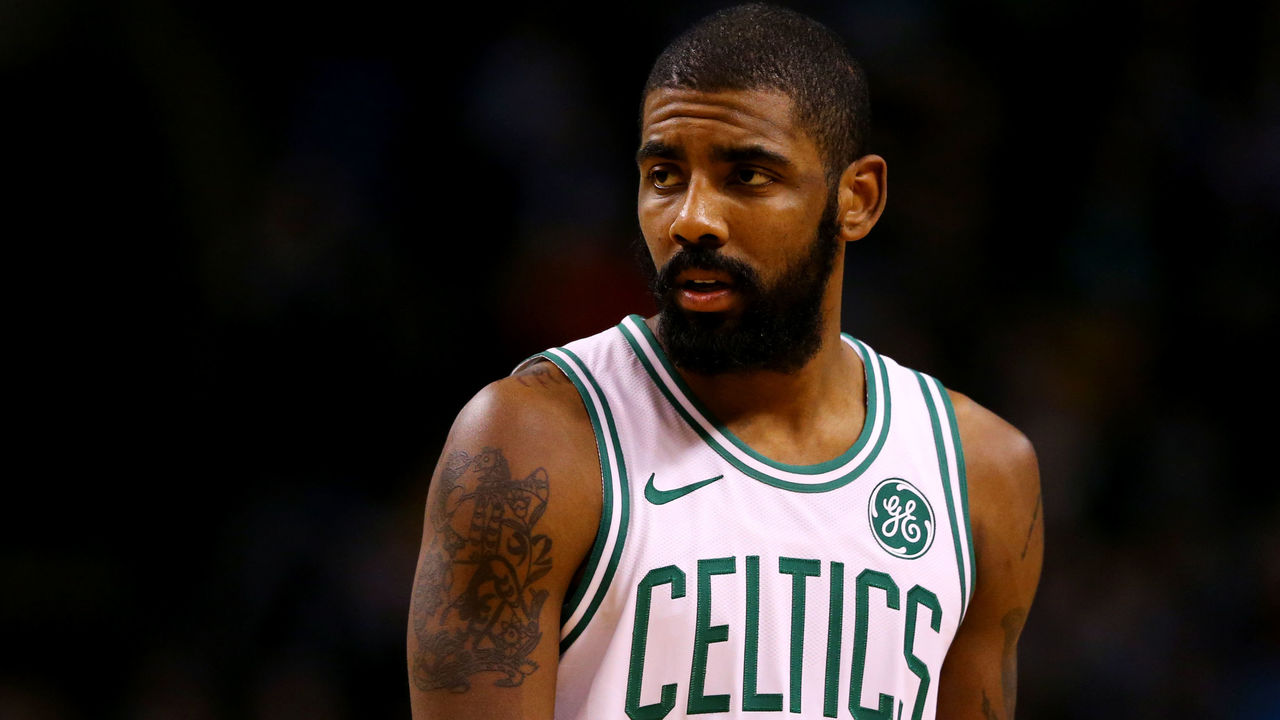 BOSTON, MA - DECEMBER 20: Kyrie Irving #11 of the Boston Celtics looks on during the second quarter against the Miami Heat at TD Garden on December 20, 2017 in Boston, Massachusetts.