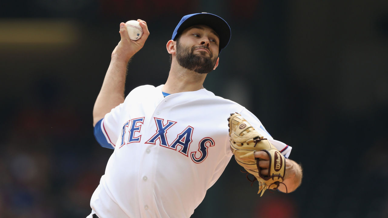 ARLINGTON, TX - SEPTEMBER 27: Nick Martinez #22 of the Texas Rangers throws against the Houston Astros in the first inning at Globe Life Park in Arlington on September 27, 2017 in Arlington, Texas.