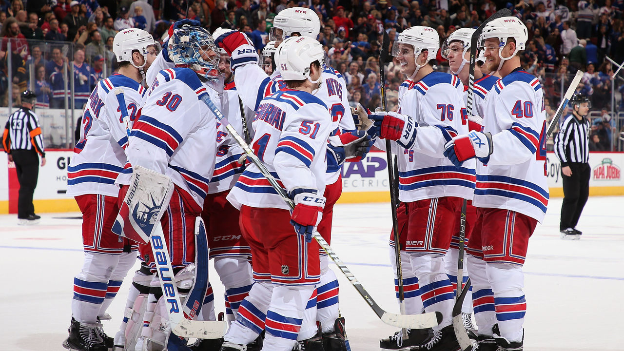GLENDALE, AZ - JANUARY 06: Goaltender Henrik Lundqvist #30 of the New York Rangers is congratulated by teammates after defeating the Arizona Coyotes in the NHL game at Gila River Arena on January 6, 2018 in Glendale, Arizona. The Rangers defeated the Coyotes 2-1 in an overtime shootout.